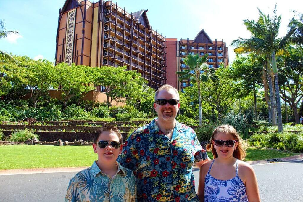 Standing in front of Aulani.