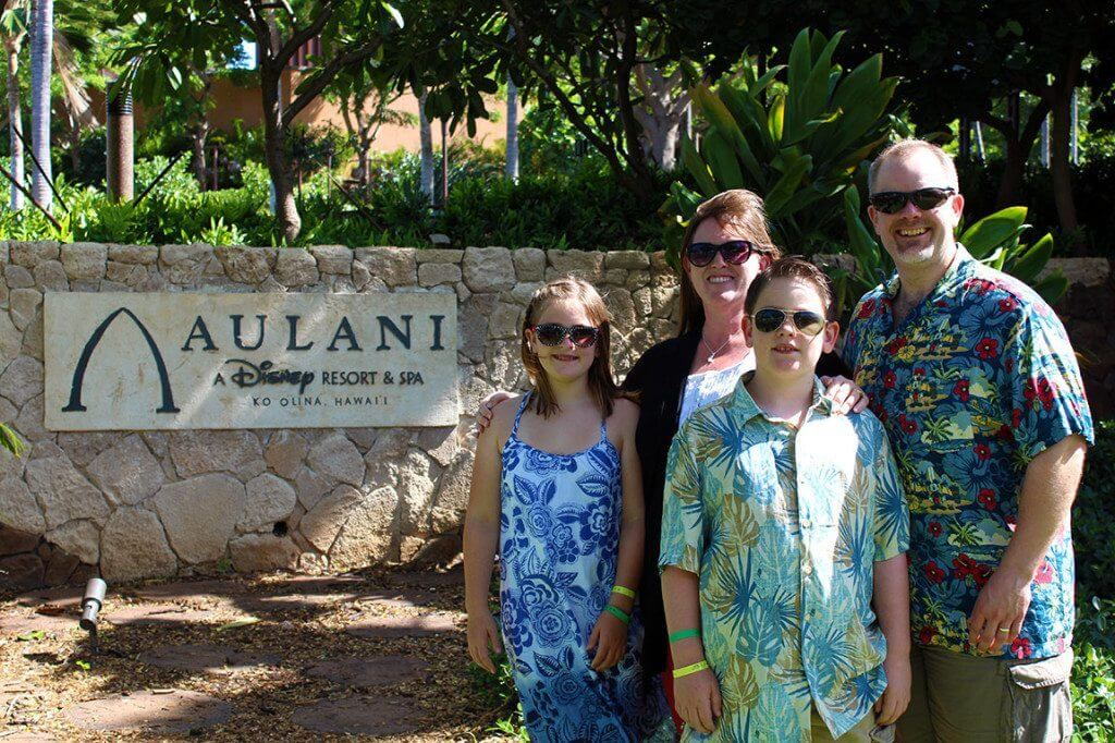 The four of us with the front Aulani sign.