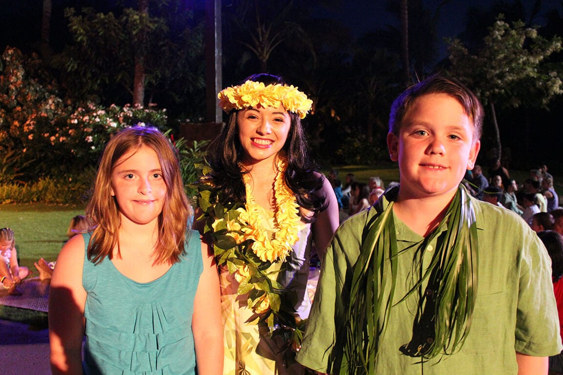 The kids with one of the hula girls