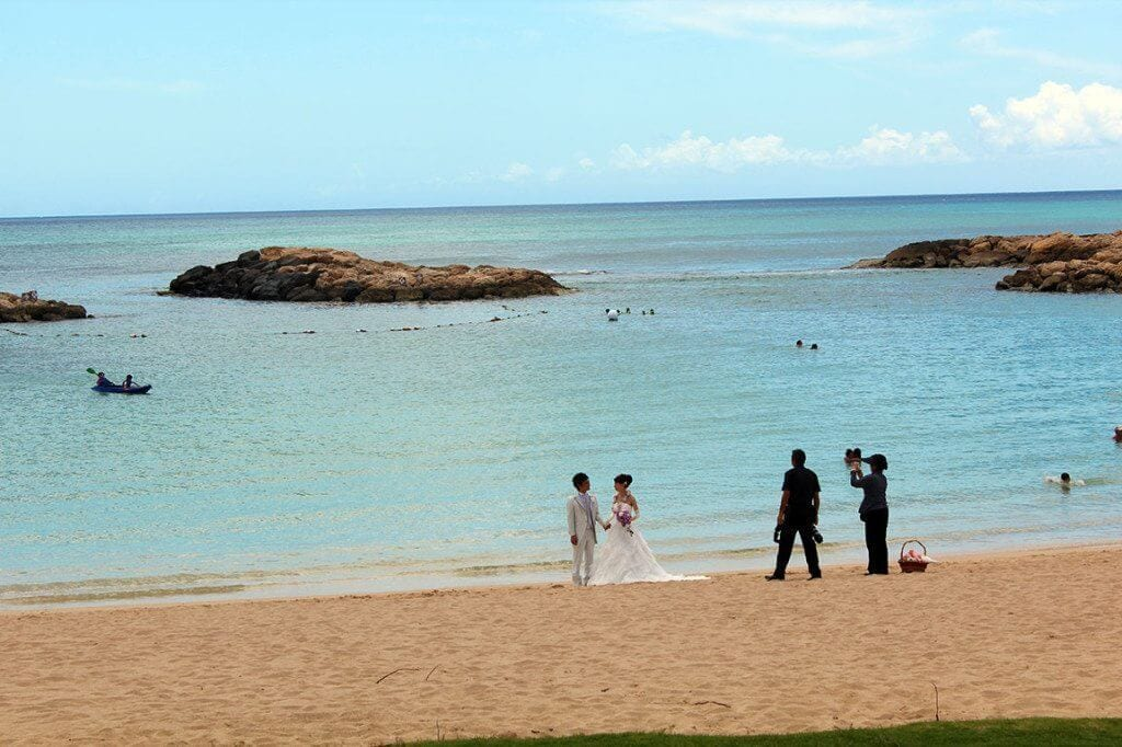 Wedding photos on the beach by Aulani.